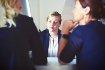 Three women in an interview